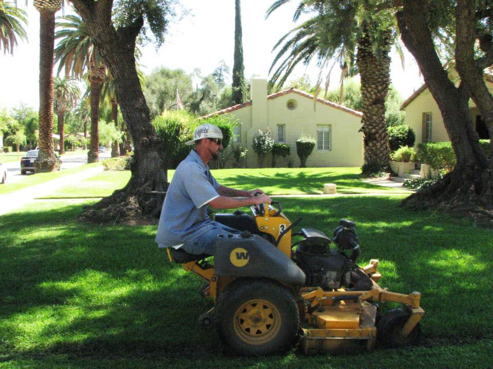 Consumer operating a rider mower.